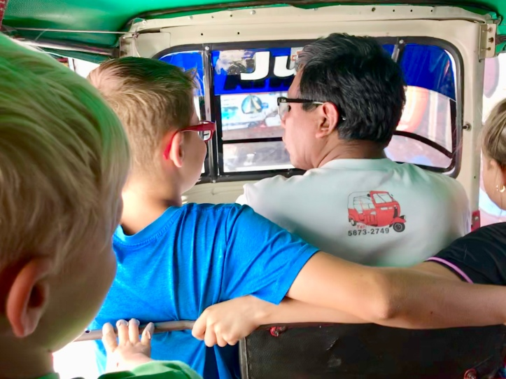 Family tuk-tuk ride in San Pedro