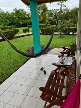 Every villa has a front porch like this one that looks out over the park-like hotel grounds, straight at Arenal Volcano.